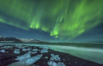 Aurora Borealis over the Ice Beach near Jokulsarlon, Iceland by John Davis/Stocktrek Images art print